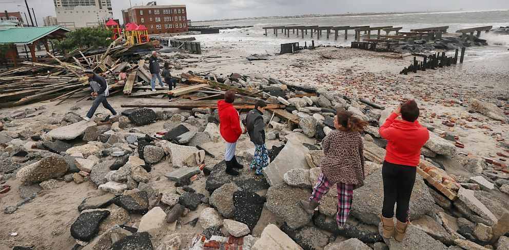 """PHOTO: People view the area where a 2000-foot section of the """"uptown"""" boardwalk was destroyed by flooding from Hurricane Sandy, Oct. 30, 2012 in Atlantic City,"""