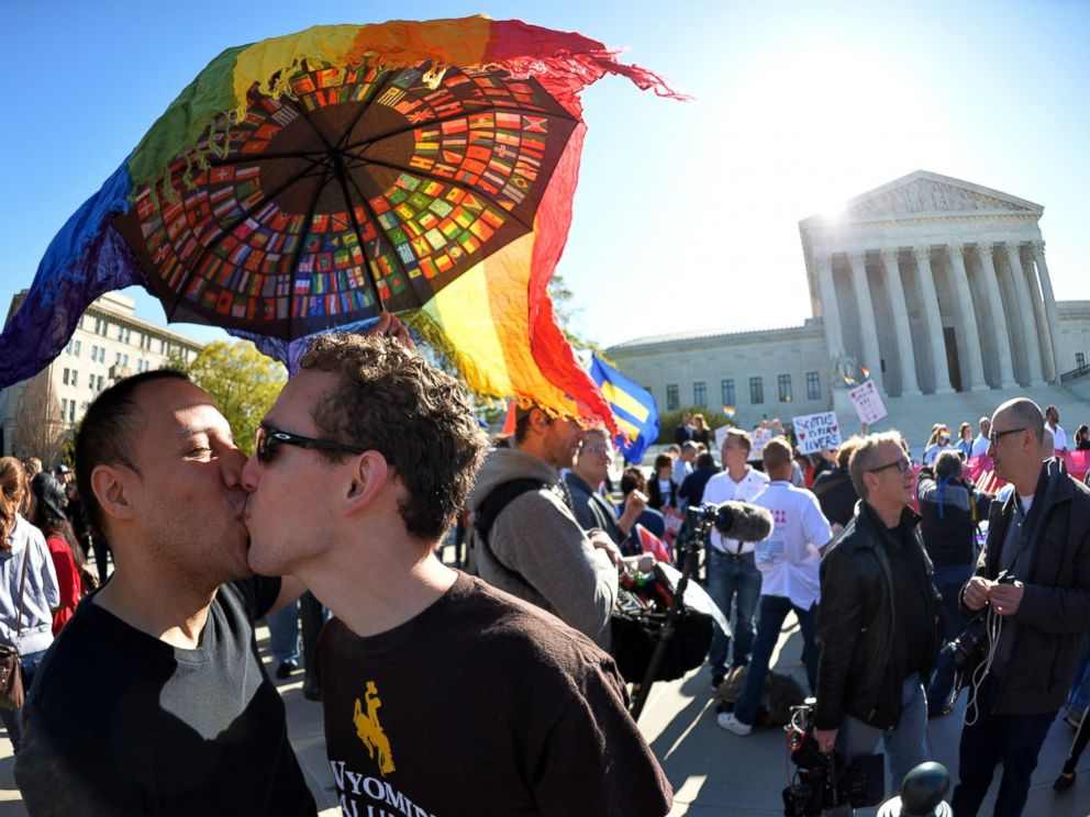 PHOTO: A gay couple kisses outside the US Supreme Court on April 28, 2015 as the court hears arguments on whether gay couples have a constitutional right to wed - a potentially historic decision that could see same-sex marriage recognized nationwide.