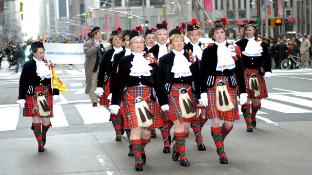 "PHOTO: People march during the ""Tunes Of Glory"" Parade celebrating ""Tartan Day"" on Sixth Ave. April 5, 2003 in New York City."