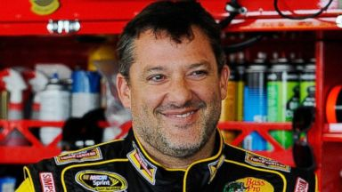 PHOTO: Tony Stewart looks on in the garage area during practice for the NASCAR Sprint Cup Series Cheez-It 355 at Watkins Glen International on Aug. 8, 2014 in Watkins Glen, New York.