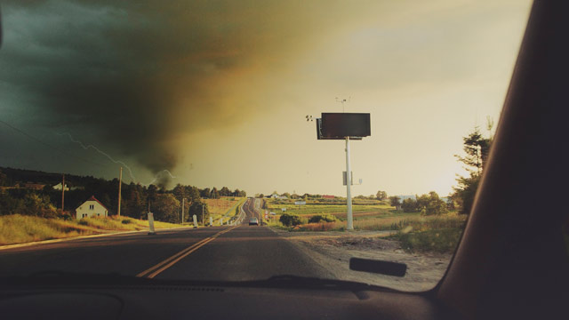 PHOTO: A tornado is seen from a car's rear window.