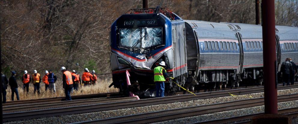 PHOTO: Emergency personnel investigate the crash site of Amtrak Palmetto train 89 on April 3, 2016 in Chester, Pennsylvania.
