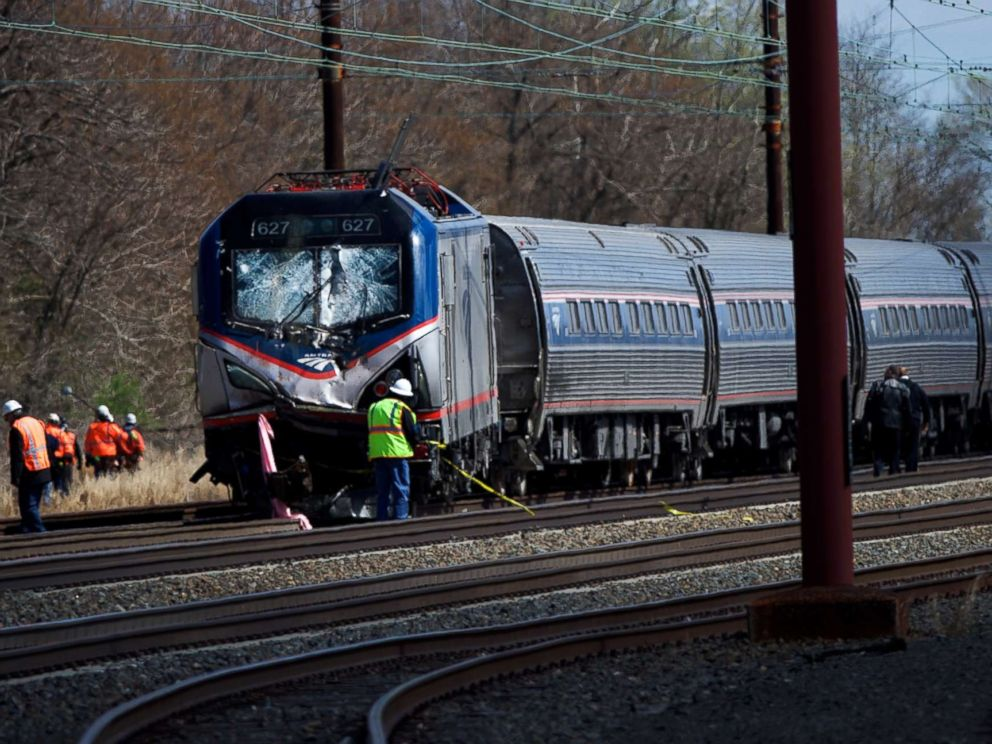PHOTO: Emergency personnel investigate the crash site of Amtrak Palmetto train 89 in this April 3, 2016 file photo in Chester, Pa.
