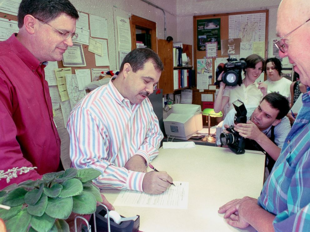 PHOTO: Joe Skirchak and Pat Cerra of Plainfield, N.H., fill out civil union paperwork with Hartland, Vt., town clerk Clyde Jenne on July 1, 2000.