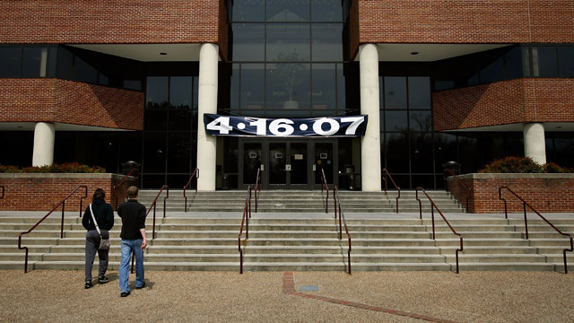 "PHOTO: A stark banner with the date ""4/16/07"" hangs over the main entrance to the Squires Student center on the campus of Virginia Tech April 18, 2007 in Blacksburg, Va."