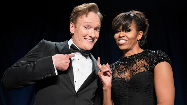 PHOTO: Comedian Conan OBrien (L) and US first lady Michelle Obama joke during the White House Correspondents Association Dinner April 27, 2013 in Washington, DC.