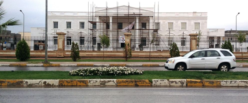 PHOTO: A car drives past a building known as Erbils White House during construction in the Iraqi Kurdish city of Erbil, Iraq, Oct. 16, 2014.