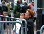 PHOTO: A woman kneels and prays at the scene of the first explosion on Boylston Street near the finish line of the 117th Boston Marathon on April 15, 2013.