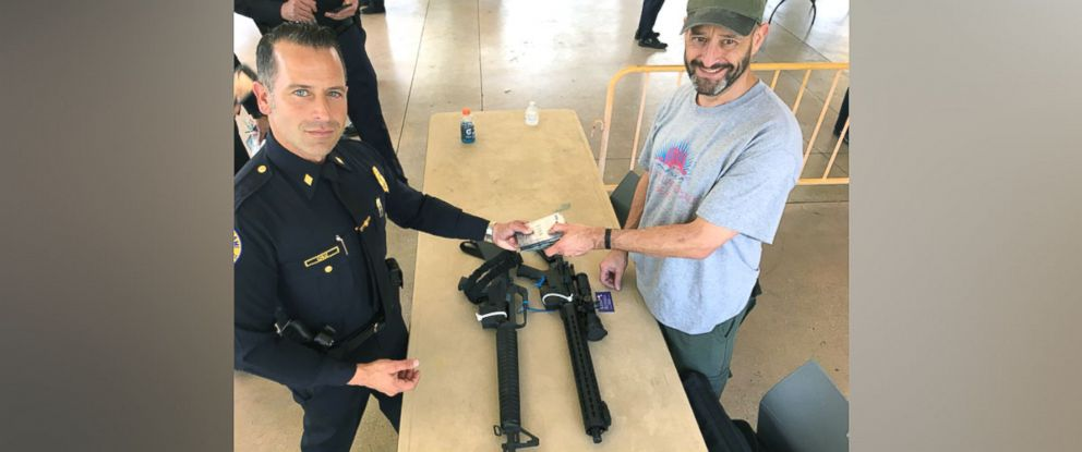 PHOTO: Steve Hemmert (right) is pictured at the Miami Police Department's gun buyback event, March 17, 2018.