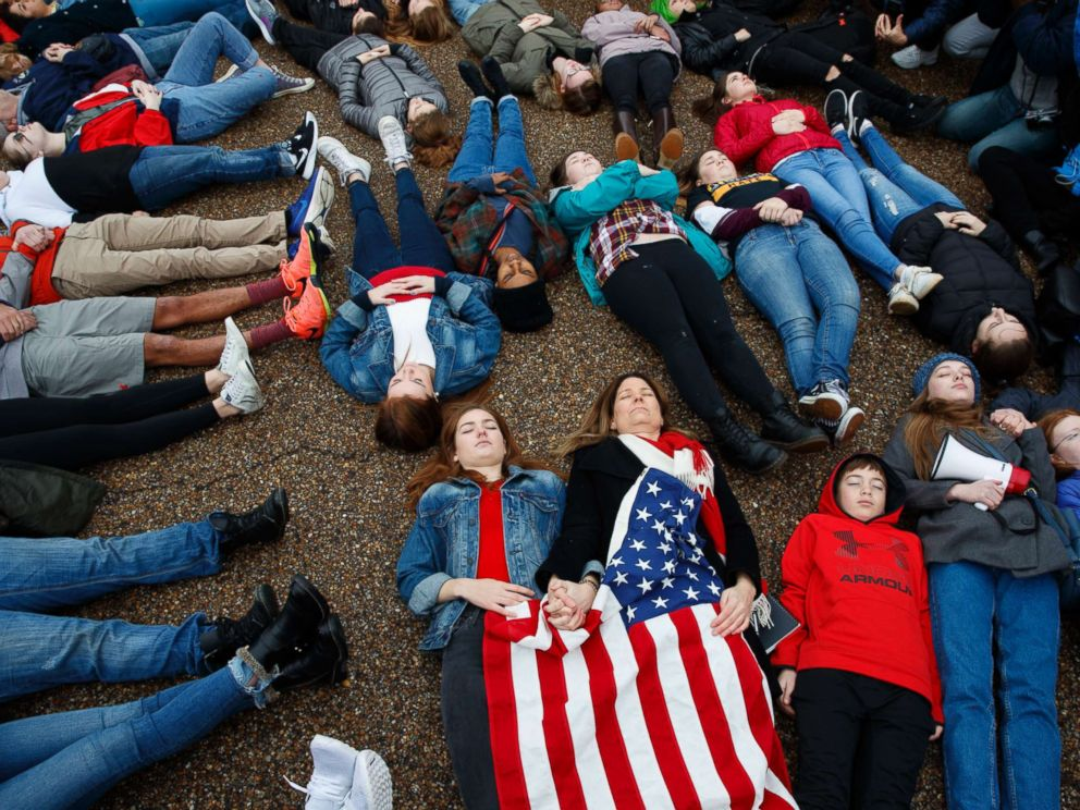 PHOTO: Abby Spangler and her daughter Eleanor Spangler Neuchterlein, 16, hold hands as they participate in a lie-in during a protest in favor of gun control reform in front of the White House in Washington, D.C., Feb. 19, 2018.