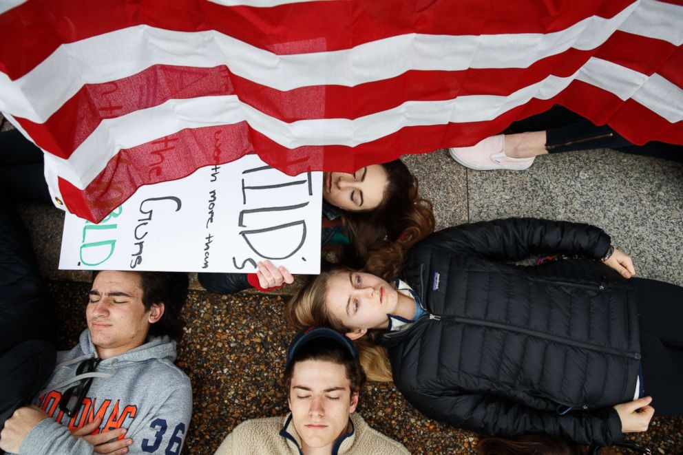 PHOTO: Anna Hurley, 15, of Washington, top, and other demonstrators participate in a lie-in during a protest in favor of gun control reform in front of the White House in Washington, D.C., Feb. 19, 2018.