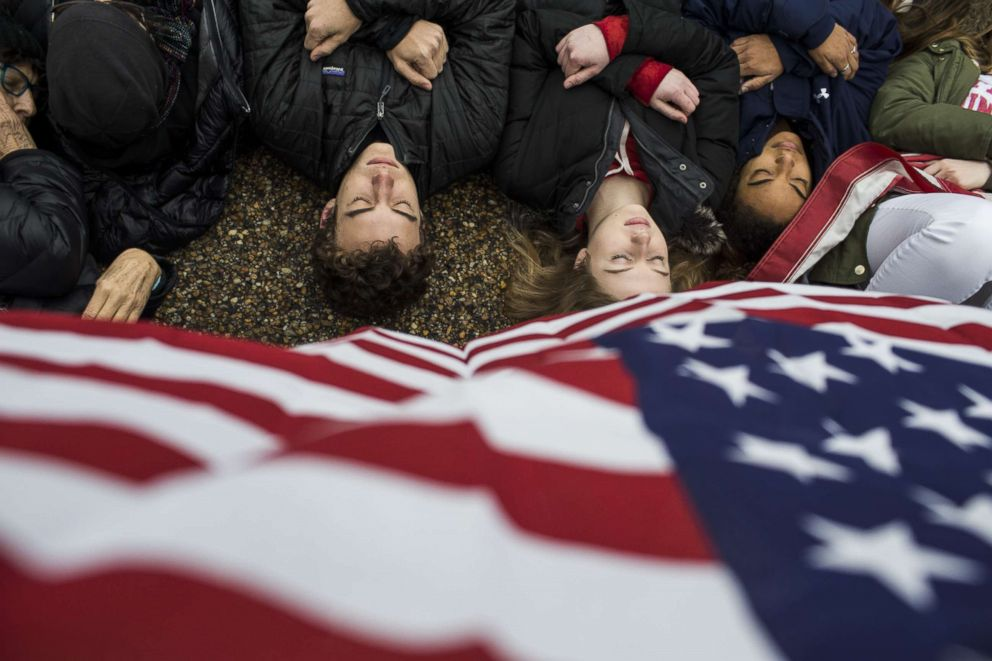"PHOTO: Demonstrators lie on the ground during a ""lie-in"" demonstration supporting gun control reform near the White House, Feb. 19, 2018, in Washington, D.C."
