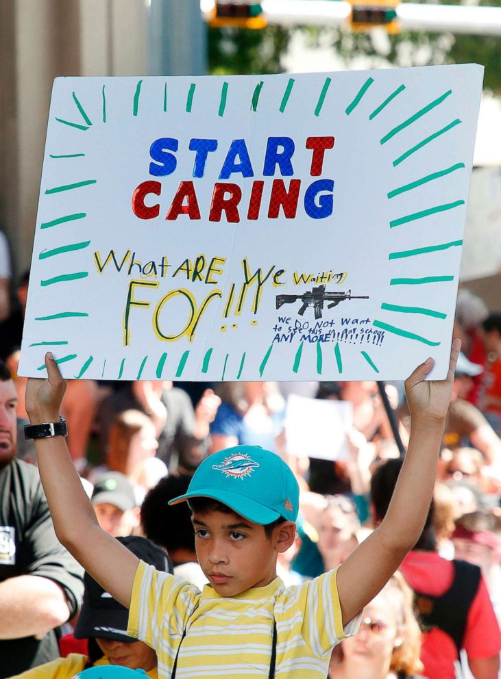 Protesters hold signs at a rally for gun control at the Broward County Federal Courthouse in Fort Lauderdale, Fla., Feb. 17, 2018.