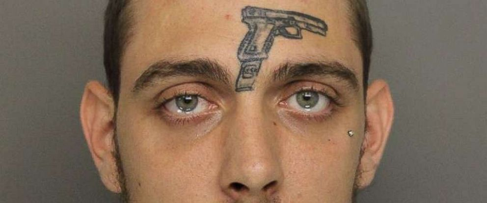 A man with a tattoo of a gun on his face was arrested and charged with illegally possessing a gun.