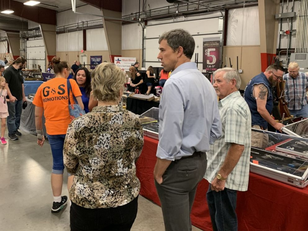 PHOTO: Beto ORourke walks around a gun show in Conway, Arkansas on August 17.