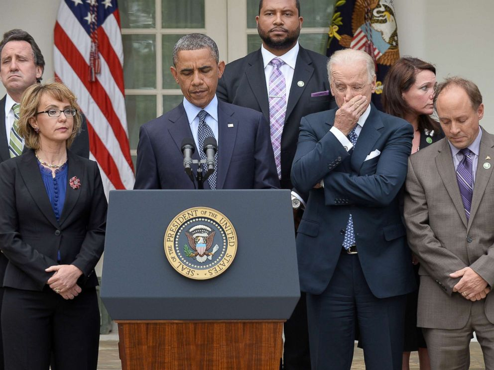 PHOTO: President Barack Obama is accompanied by former lawmaker Gabrielle Giffords, vice president Joe Biden and family members of Newtown school shooting victims as he speaks on gun control at the Rose Garden of the White House in Washington.