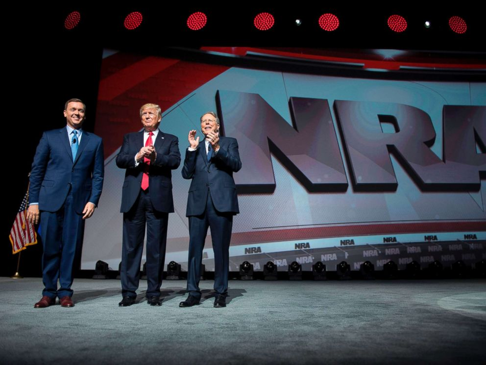PHOTO: President Donald Trump stands with National Rifle Association (NRA) President Wayne LaPierre, right, and NRA-ILA Executive Director Chris Cox during the NRA Leadership Forum in Atlanta, April 28, 2017.