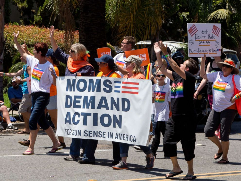 PHOTO: Moms demand action for gun sense in America, carry a banner at the San Diego Pride Parade.