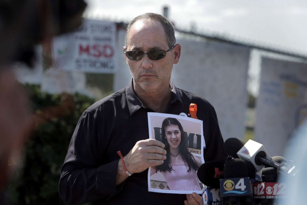 PHOTO: Fred Guttenberg holds a picture of his slain daughter, Jaime, as he listens to questions from the media in front Stoneman Douglas high school, March 5, 2018 in Parkland, Fla.