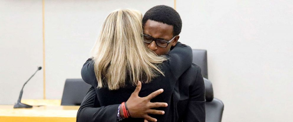 PHOTO: Botham Jeans younger brother Brandt Jean hugs former Dallas police officer Amber Guyger following her 10-year prison sentence for murder at the Frank Crowley Courts Building in Dallas, Texas, Oct. 2, 2019.