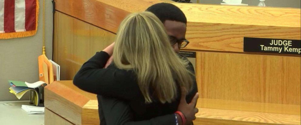 PHOTO: Botham Jeans brother Brandt hugs Amber Guyger after her sentencing, Oct 2, 2019.