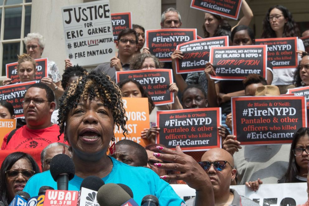 PHOTO: Gwen Carr, whose son Eric Garner was killed by an NYPD officer, is surrounded by supporters as she speak during a news conference outside City Hall, July 17, 2018, in New York.