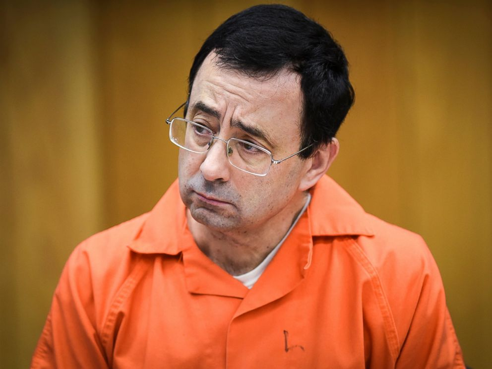 In this Feb. 2, 2018, file photo, Larry Nassar listens as Melissa Alexander Vigogne gives her victim statement in Eaton County Circuit Court in Charlotte, Michigan.