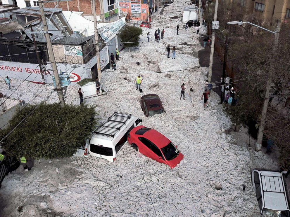 PHOTO: Vehicles are buried in hail in the streets in the eastern area of Guadalajara, Jalisco state, Mexico, June 30, 2019.