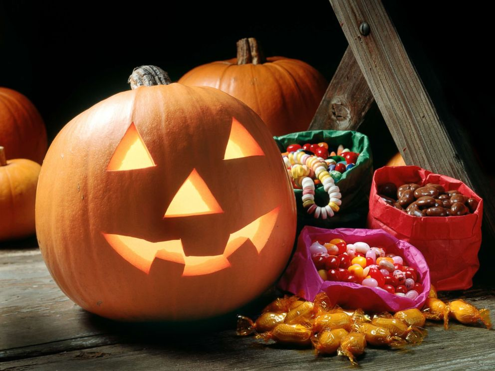 PHOTO: Halloween pumpkin with candy.