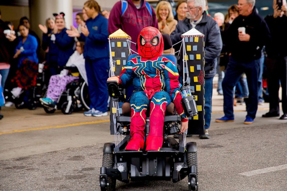 PHOTO: Children take part in the third annual Halloween Heroes wheelchair parade at Mary Free Bed Rehabilitation Hospital in Grand Rapids, Michigan.