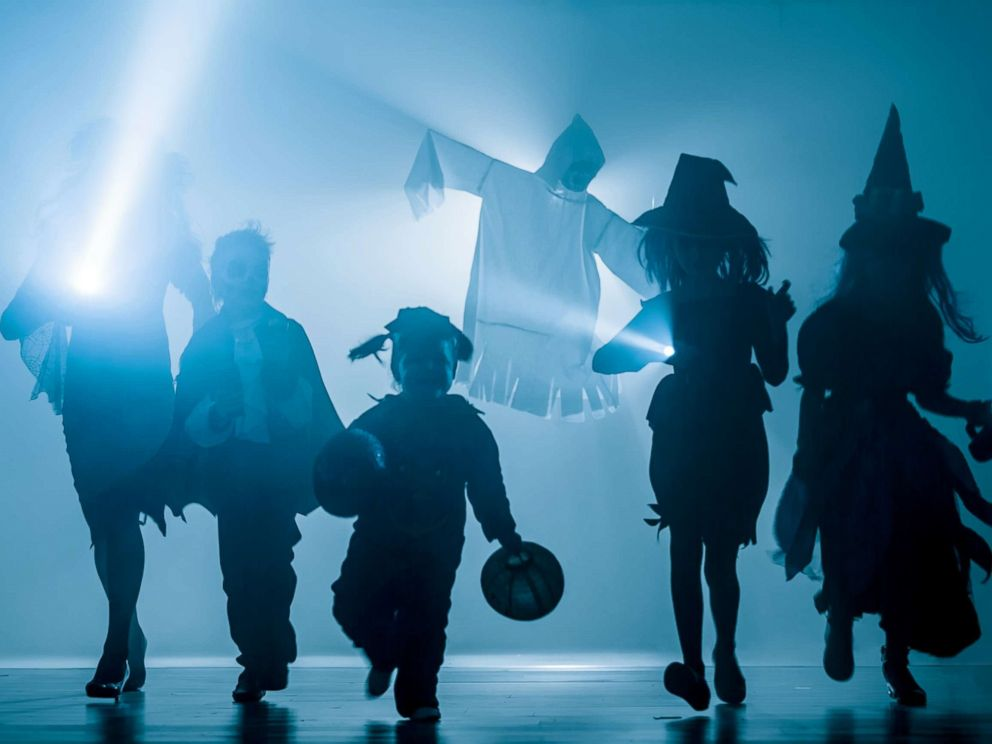 PHOTO: Silhouettes of children dressed in Halloween costumes.