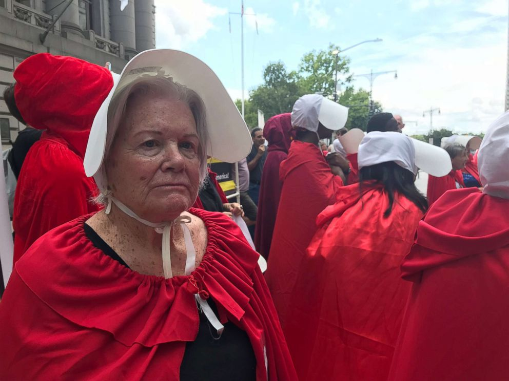 PHOTO: Marion Marino, 84, donned the garb of the fictional Handmaids Tale to protest the Trump administrations stance toward abortion rights in New York July 31.