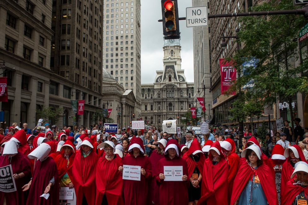PHOTO: Demonstrators dressed as characters from the novel-turned-TV series The Handmaids Tale gather outside of the Union League where Vice President Mike Pence attended a fundraiser for Rep. Lou Barletta, July 23, 2018, in Philadelphia