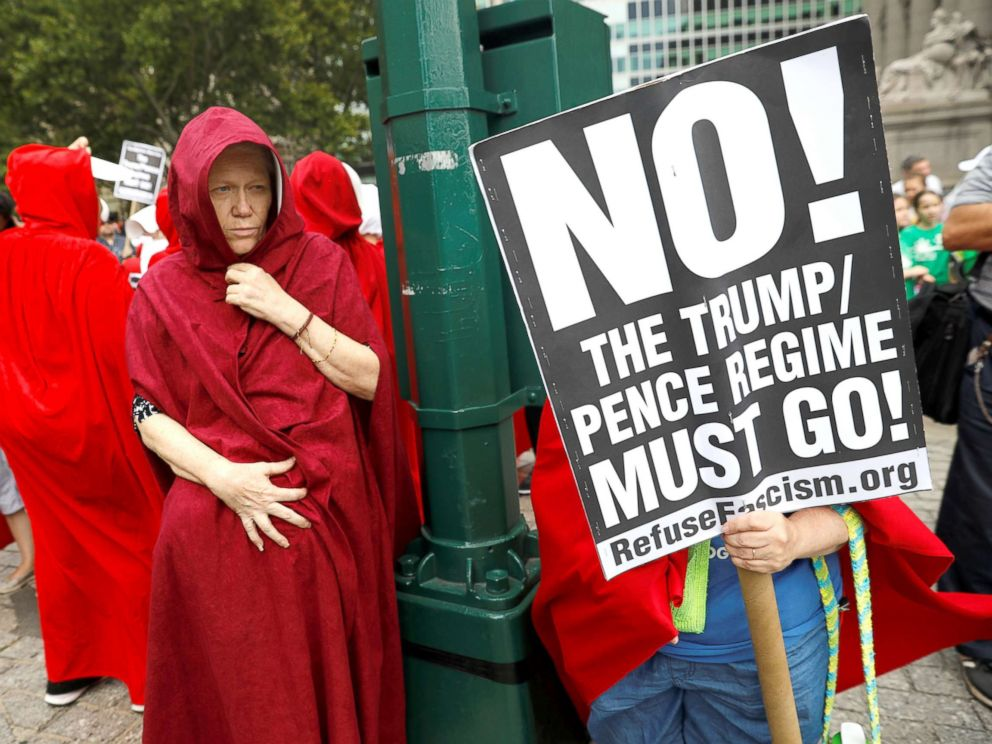 PHOTO: Women dressed in red gowns as worn in the Handmaids Tale protest outside the Department of Homeland Security (DHS) Cybersecurity Summit where U.S. Vice President Mike Pence, July 31, 2018, in Manhattan, New York City.