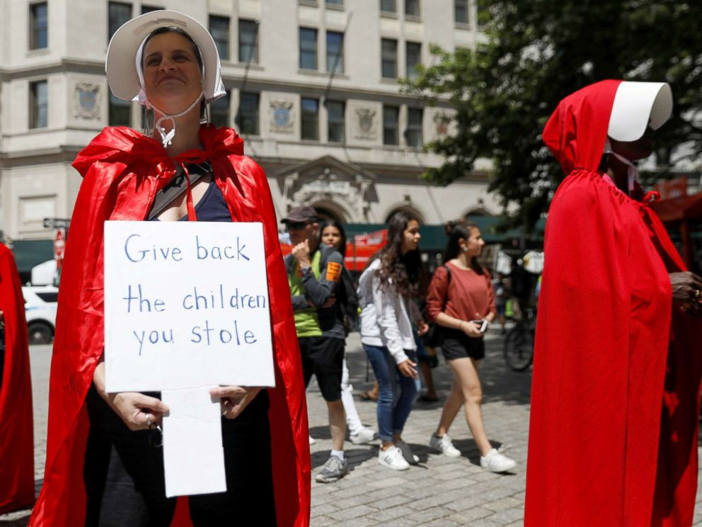 PHOTO: Women dressed in red gowns as worn in the Handmaids Tale protest U.S. Vice President Mike Pence and Department of Homeland Security (DHS) Secretary Kirstjen Nielsen outside the DHS Cybersecurity Summit in New York City, July 31, 2018.