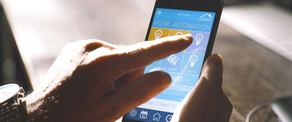 PHOTO: A person uses a home automation application on a smartphone in an undated stock photo.