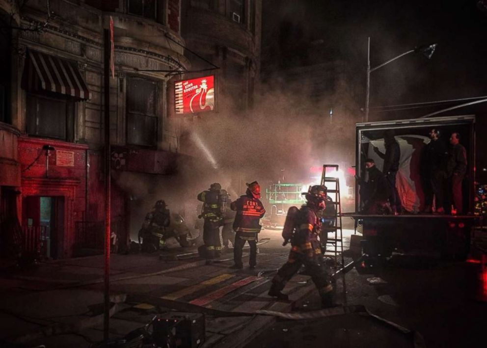 Firefighters on the scene of a fire in Harlem that claimed one of their own.