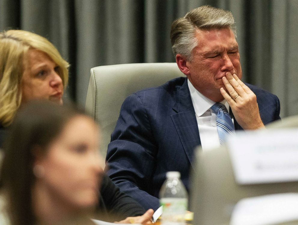 Mark Harris, Republican candidate in North Carolina's 9th Congressional race, fights back tears at the conclusion of his son John Harris's testimony on the 9th Congressional District voting irregularities investigation, Feb. 20, 2019, at the North Carolina State Bar in Raleigh, N.C.