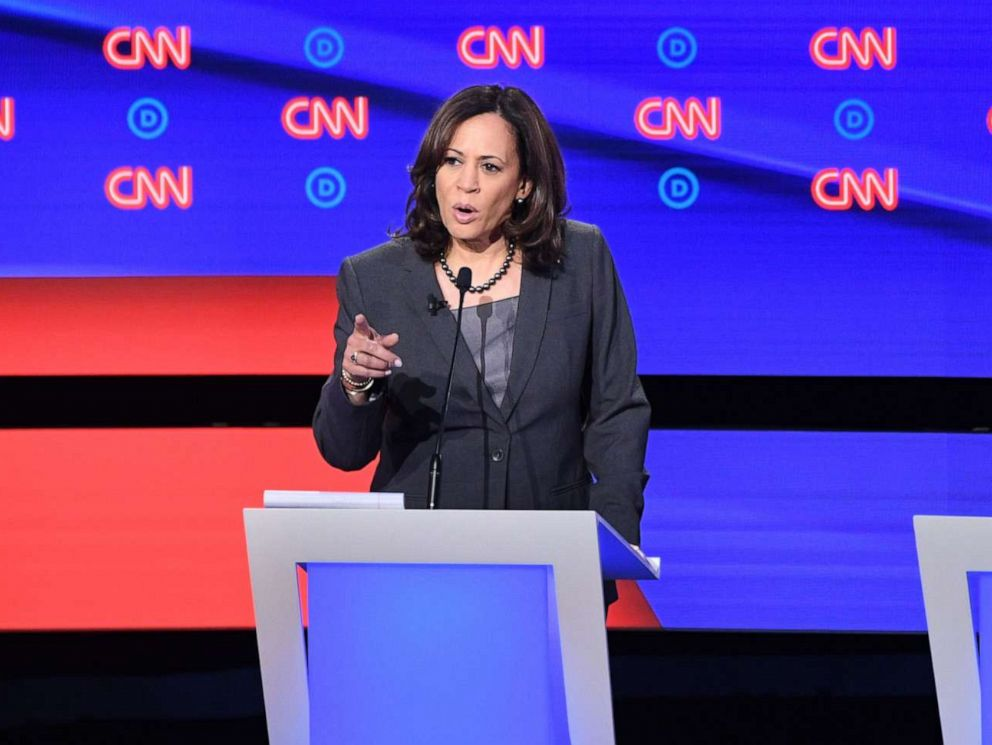 PHOTO: Kamala Harris delivers her closing statement flanked by Joe Biden and Andrew Yang during the second round of the second Democratic primary debate in Detroit, Michigan on July 31, 2019.