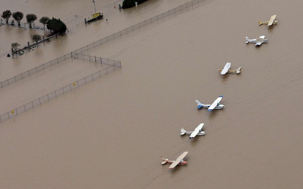 PHOTO: Airplanes sit at a flooded airport near the Addicks Reservoir as floodwaters from Tropical Storm Harvey rise, Aug. 29, 2017, in Houston, Texas.