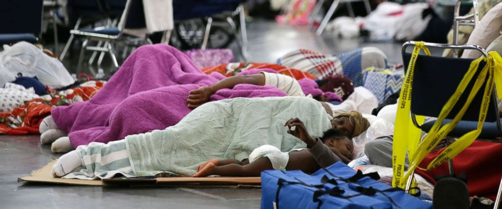 PHOTO: People sleep on the floor at the George R. Brown Convention Center that has been set up as a shelter for evacuees escaping the floodwaters from Hurricane Harvey in Houston, Aug. 29, 2017.
