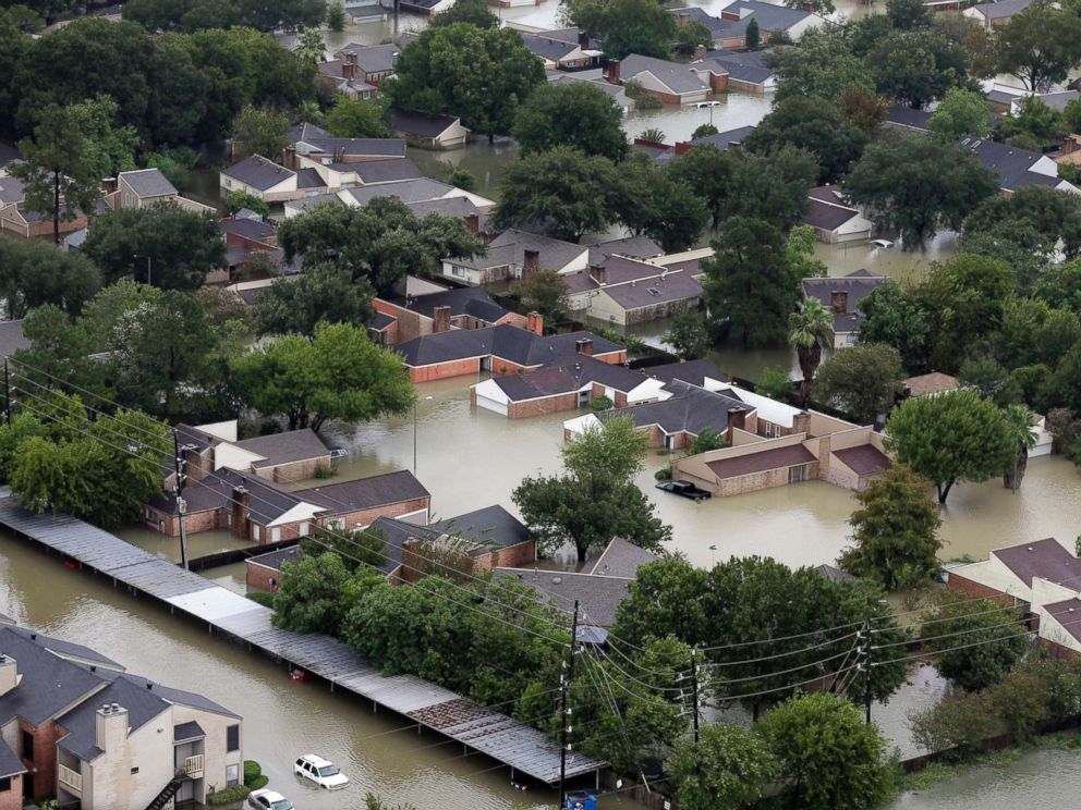PHOTO: Homes are flooded near the Addicks Reservoir as floodwaters from Tropical Storm Harvey rise Tuesday, Aug. 29, 2017, in Houston.