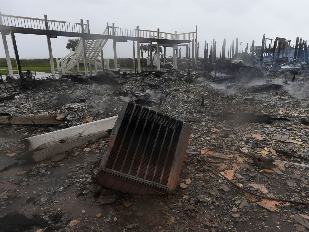 PHOTO: Debris from the charred remains of three Bolivar, Texas, beach cabins, destroyed by a fire that broke out when Hurricane Harvey made landfall, lies on the ground, Aug. 26, 2017.