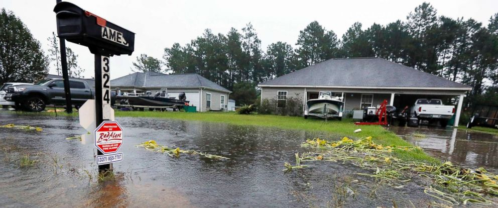 PHOTO: Rising waters threaten homes in Moss Bluff, La., as constant rain from Tropical Storm Harvey falls on Aug. 28, 2017.