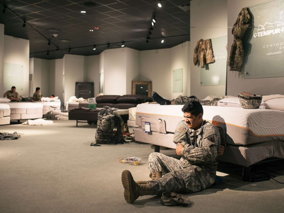 PHOTO: Members of the National Guard rest at a Gallery Furniture store in Richmond, Texas, Aug. 29, 2017.