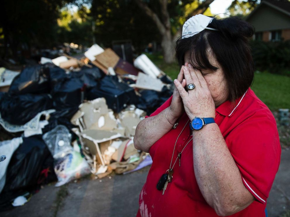 PHOTO: Peggy Lanigan pauses during the aftermath of Hurricane Harvey in Houston, Sept. 6, 2017.