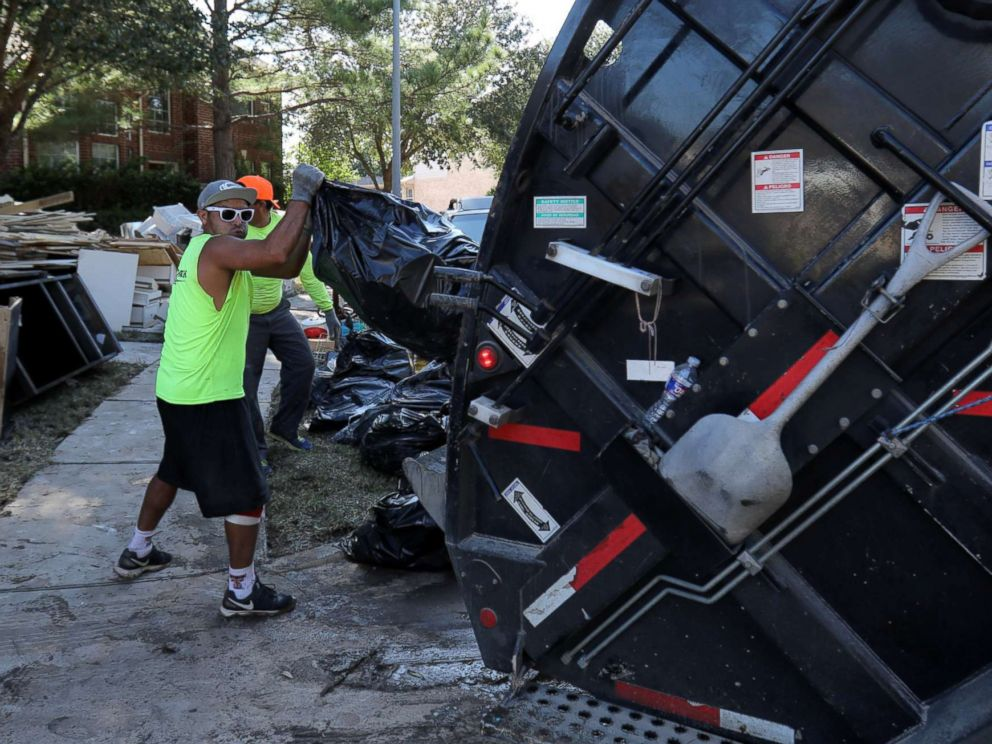 PHOTO: A garbage truck helps residents remove bags of flood-damaged items that line the streets of numerous neighborhoods in the aftermath of tropical storm Harvey on the west side of Houston, Texas, U.S., Sept. 7, 2017.