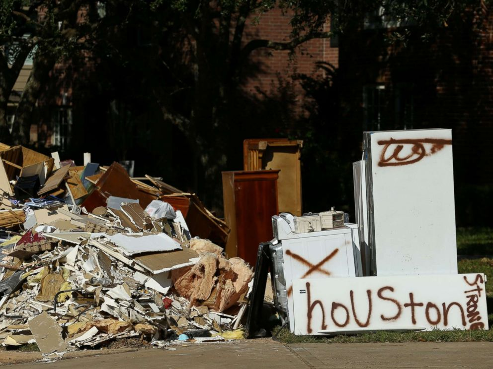 PHOTO: Flood-damaged contents from homes line the roads along residential streets in the aftermath of Harvey on the west side of Houston, Sept. 7, 2017.