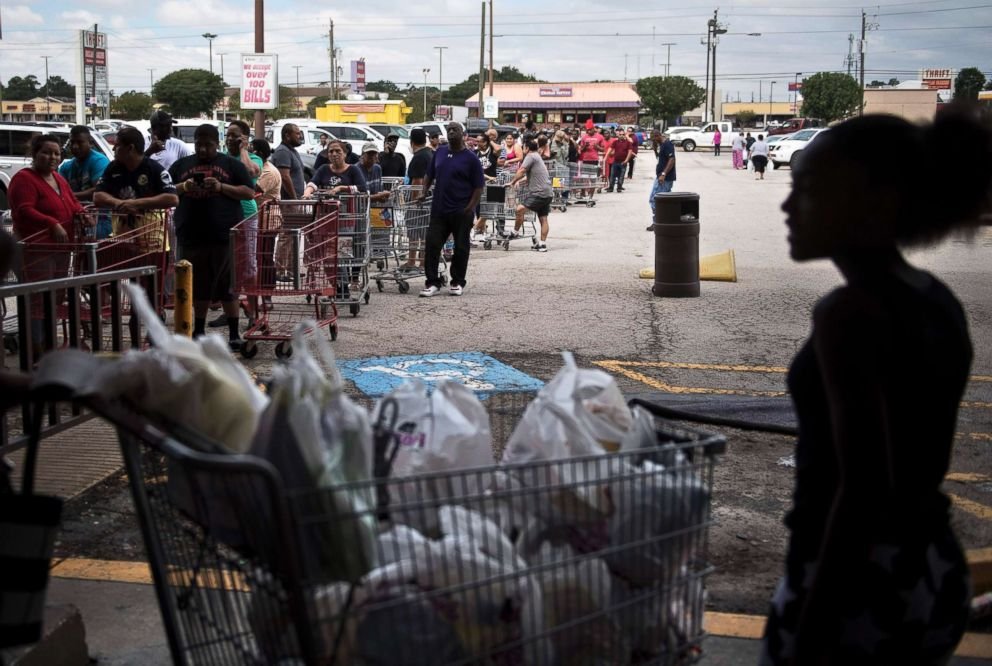 PHOTO: People wait in line to buy groceries at a Food Town during the aftermath of Hurricane Harvey on Aug. 30, 2017 in Houston, Texas.