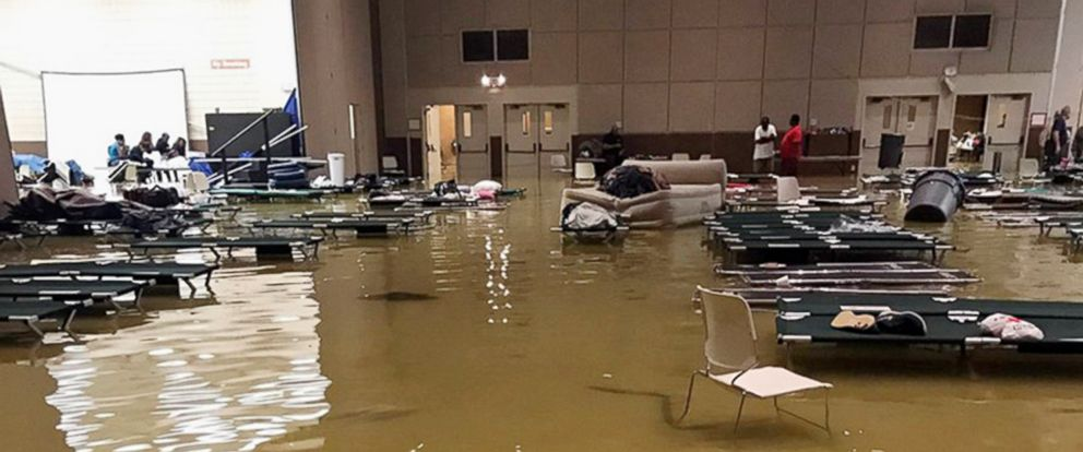 PHOTO: Cots and belongings sit in high water at the Bowers Civic Center in Port Arthur, Texas, Wednesday, Aug. 30, 2017, after floodwaters caused by Tropical Storm Harvey overcame the facility that was being used as a shelter.